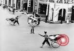 Image of natives in city Singapore, 1937, second 25 stock footage video 65675043495