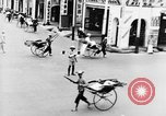 Image of natives in city Singapore, 1937, second 26 stock footage video 65675043495