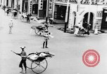 Image of natives in city Singapore, 1937, second 28 stock footage video 65675043495