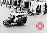 Image of natives in city Singapore, 1937, second 29 stock footage video 65675043495