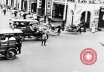 Image of natives in city Singapore, 1937, second 30 stock footage video 65675043495