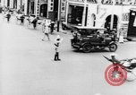 Image of natives in city Singapore, 1937, second 31 stock footage video 65675043495