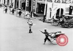 Image of natives in city Singapore, 1937, second 32 stock footage video 65675043495