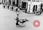 Image of natives in city Singapore, 1937, second 33 stock footage video 65675043495