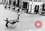 Image of natives in city Singapore, 1937, second 34 stock footage video 65675043495