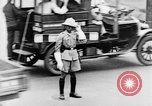Image of natives in city Singapore, 1937, second 41 stock footage video 65675043495