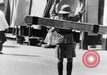 Image of natives in city Singapore, 1937, second 46 stock footage video 65675043495