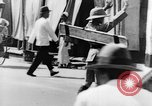 Image of natives in city Singapore, 1937, second 47 stock footage video 65675043495