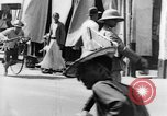 Image of natives in city Singapore, 1937, second 48 stock footage video 65675043495