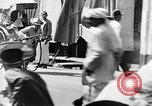 Image of natives in city Singapore, 1937, second 49 stock footage video 65675043495