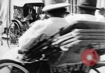 Image of natives in city Singapore, 1937, second 50 stock footage video 65675043495