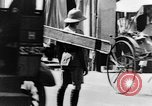 Image of natives in city Singapore, 1937, second 53 stock footage video 65675043495