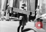 Image of natives in city Singapore, 1937, second 54 stock footage video 65675043495