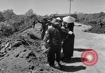 Image of highway construction Vietnam, 1957, second 13 stock footage video 65675043578