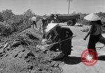 Image of highway construction Vietnam, 1957, second 15 stock footage video 65675043578