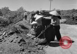 Image of highway construction Vietnam, 1957, second 16 stock footage video 65675043578