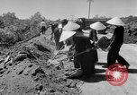 Image of highway construction Vietnam, 1957, second 18 stock footage video 65675043578