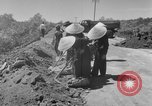 Image of highway construction Vietnam, 1957, second 21 stock footage video 65675043578