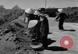 Image of highway construction Vietnam, 1957, second 22 stock footage video 65675043578