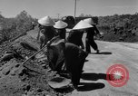 Image of highway construction Vietnam, 1957, second 23 stock footage video 65675043578