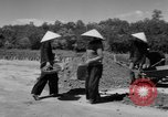 Image of highway construction Vietnam, 1957, second 26 stock footage video 65675043578