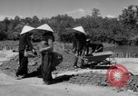 Image of highway construction Vietnam, 1957, second 27 stock footage video 65675043578