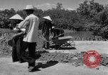 Image of highway construction Vietnam, 1957, second 29 stock footage video 65675043578