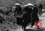 Image of highway construction Vietnam, 1957, second 47 stock footage video 65675043578