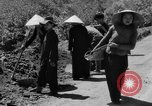Image of highway construction Vietnam, 1957, second 51 stock footage video 65675043578