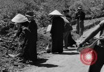 Image of highway construction Vietnam, 1957, second 53 stock footage video 65675043578