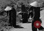 Image of highway construction Vietnam, 1957, second 58 stock footage video 65675043578