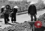 Image of highway construction Vietnam, 1957, second 62 stock footage video 65675043578
