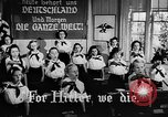 Image of fascist children in uniform Germany, 1942, second 21 stock footage video 65675043614