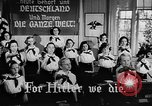 Image of fascist children in uniform Germany, 1942, second 22 stock footage video 65675043614