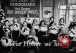 Image of fascist children in uniform Germany, 1942, second 23 stock footage video 65675043614