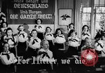 Image of fascist children in uniform Germany, 1942, second 24 stock footage video 65675043614