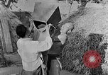 Image of bean cakes China, 1938, second 19 stock footage video 65675050390