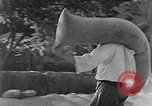 Image of bean cakes China, 1938, second 27 stock footage video 65675050390
