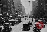 Image of Busy city street with traffic circa 1925 United States USA, 1925, second 14 stock footage video 65675050488