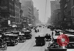 Image of Busy city street with traffic circa 1925 United States USA, 1925, second 16 stock footage video 65675050488