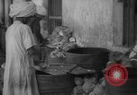 Image of shelling and drying of coconut Caracas Venezuela, 1940, second 5 stock footage video 65675050637