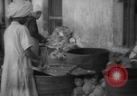 Image of shelling and drying of coconut Caracas Venezuela, 1940, second 6 stock footage video 65675050637