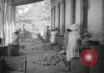 Image of shelling and drying of coconut Caracas Venezuela, 1940, second 44 stock footage video 65675050637