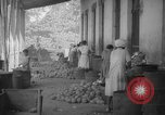 Image of shelling and drying of coconut Caracas Venezuela, 1940, second 46 stock footage video 65675050637