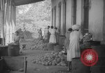 Image of shelling and drying of coconut Caracas Venezuela, 1940, second 47 stock footage video 65675050637