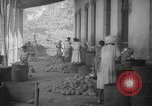 Image of shelling and drying of coconut Caracas Venezuela, 1940, second 48 stock footage video 65675050637
