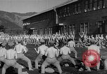 Image of Japanese high school boys train with soldiers Japan, 1942, second 28 stock footage video 65675050776