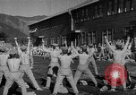 Image of Japanese high school boys train with soldiers Japan, 1942, second 30 stock footage video 65675050776