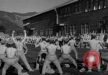 Image of Japanese high school boys train with soldiers Japan, 1942, second 33 stock footage video 65675050776