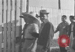 Image of Filipino men working under Japanese occupation Manila Philippines, 1942, second 13 stock footage video 65675050780